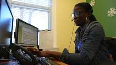Lucie Bolden, a 311 representative, works in the