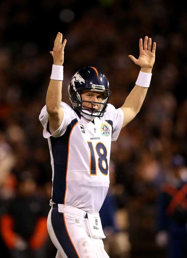Broncos quarterback Peyton Manning celebrates after the Broncos