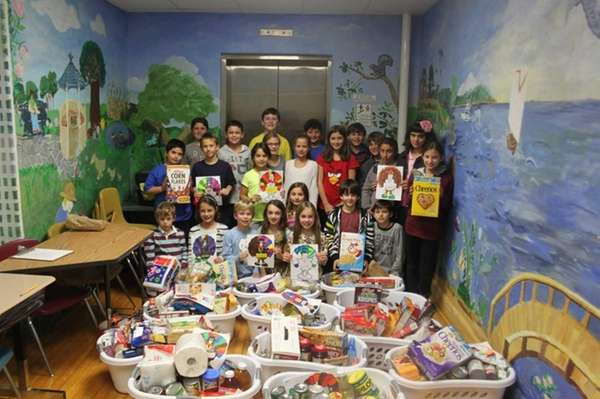 Locust Valley Intermediate School students collected ?more food
