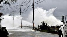 Waves beat the seawall on Asharoken Avenue as