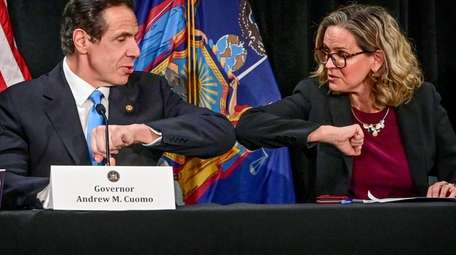 New York State Governor Andrew Cuomo Left, elbow