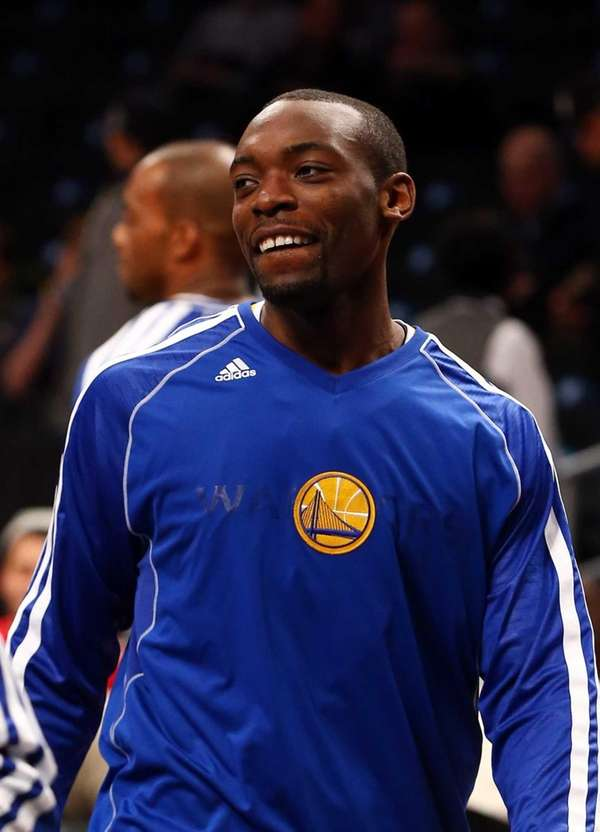 Charles Jenkins of the Golden State Warriors warms