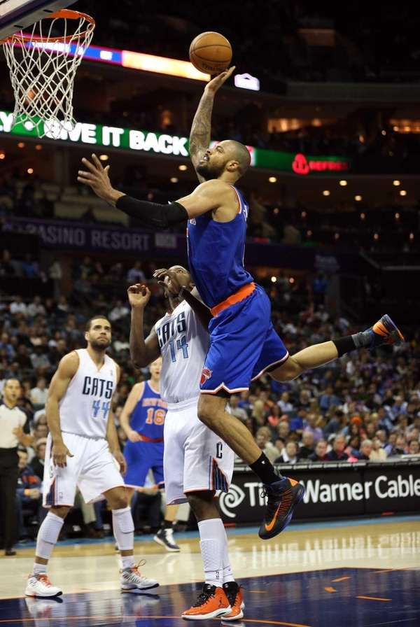 Tyson Chandler of the New York Knicks drives