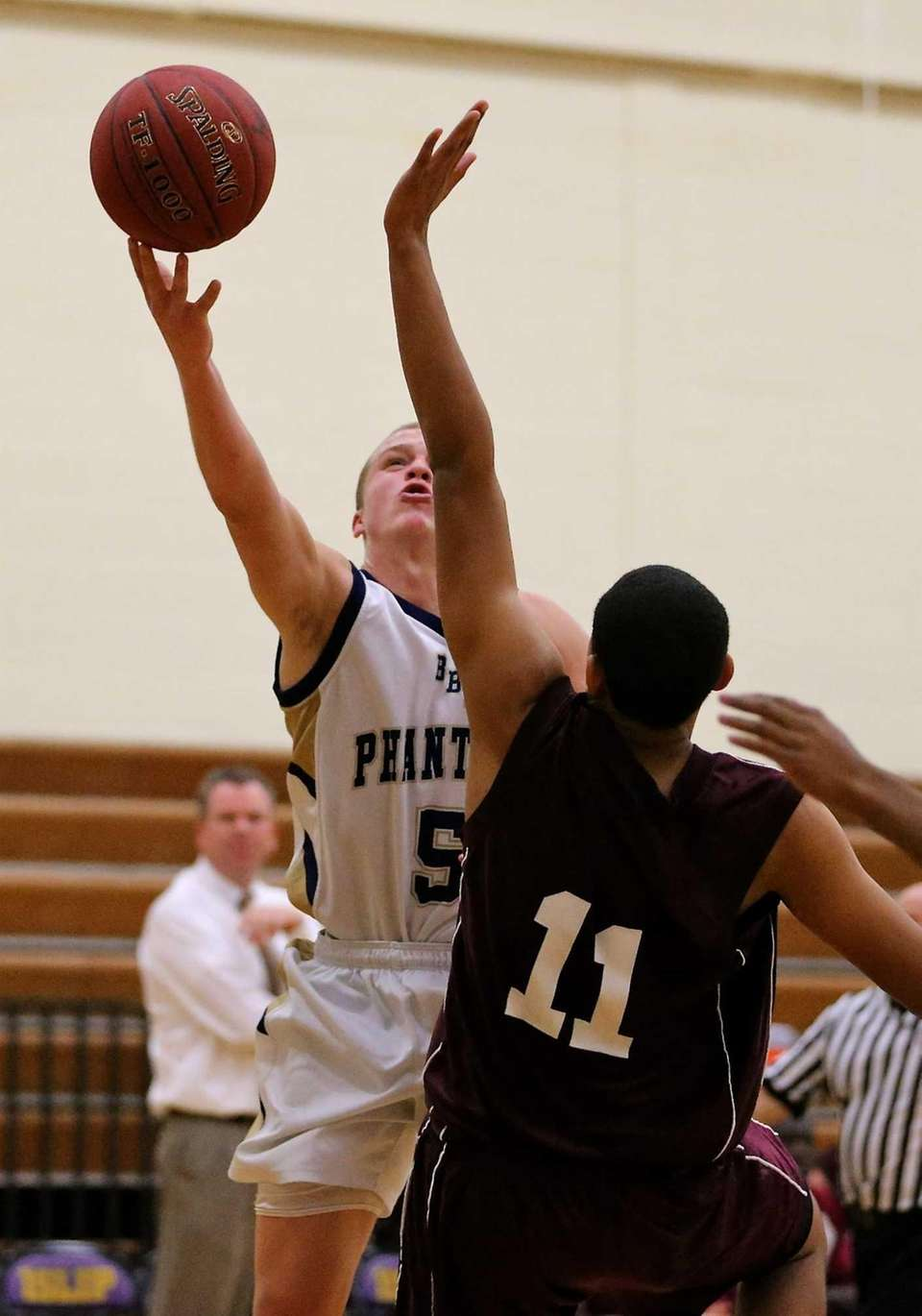 Bayport's Conner Panzner drives the baseline with a
