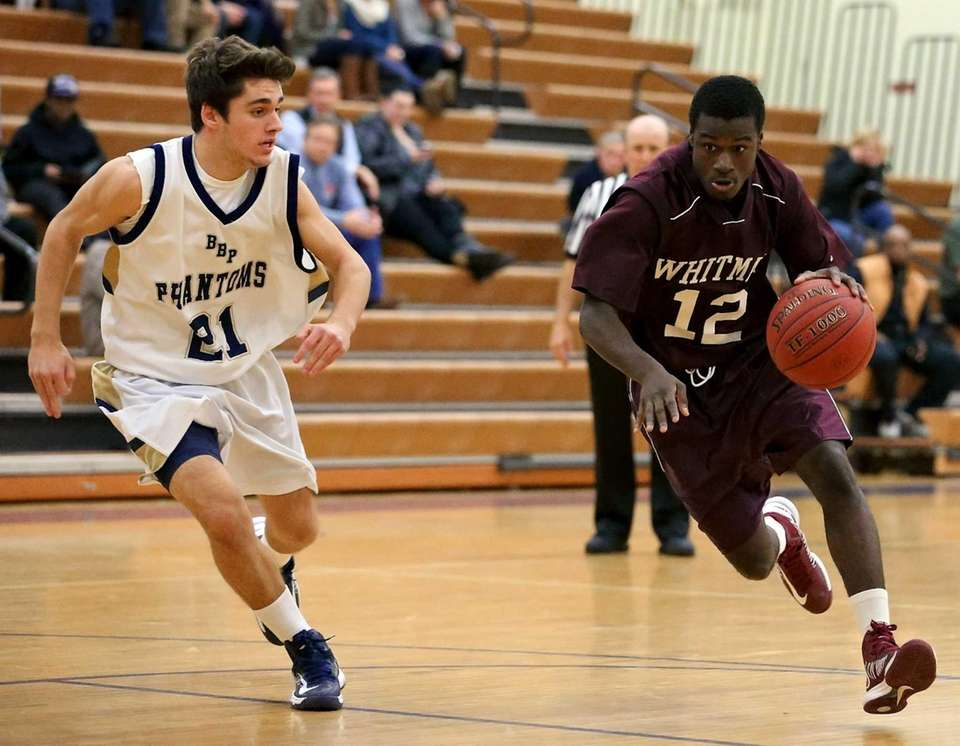 Whitman's Travaun Patron drives the lane as Bayport's