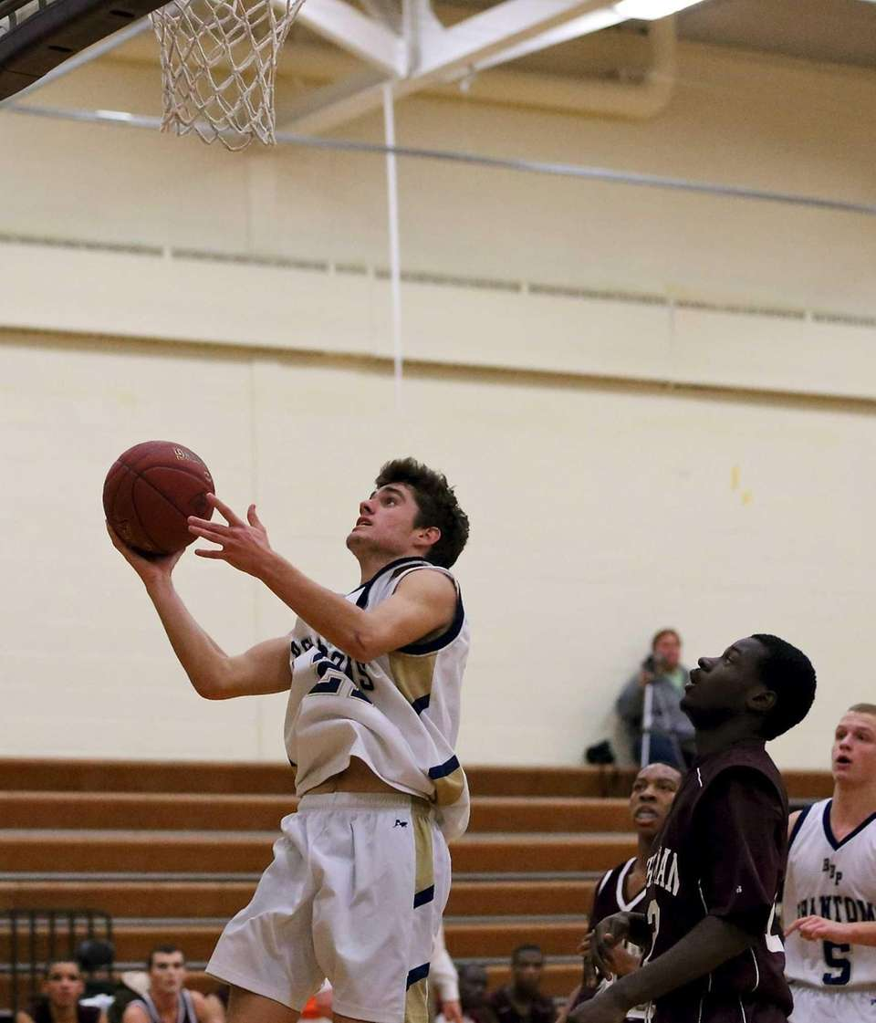 Bayport's Dylan Adams puts in the layup against