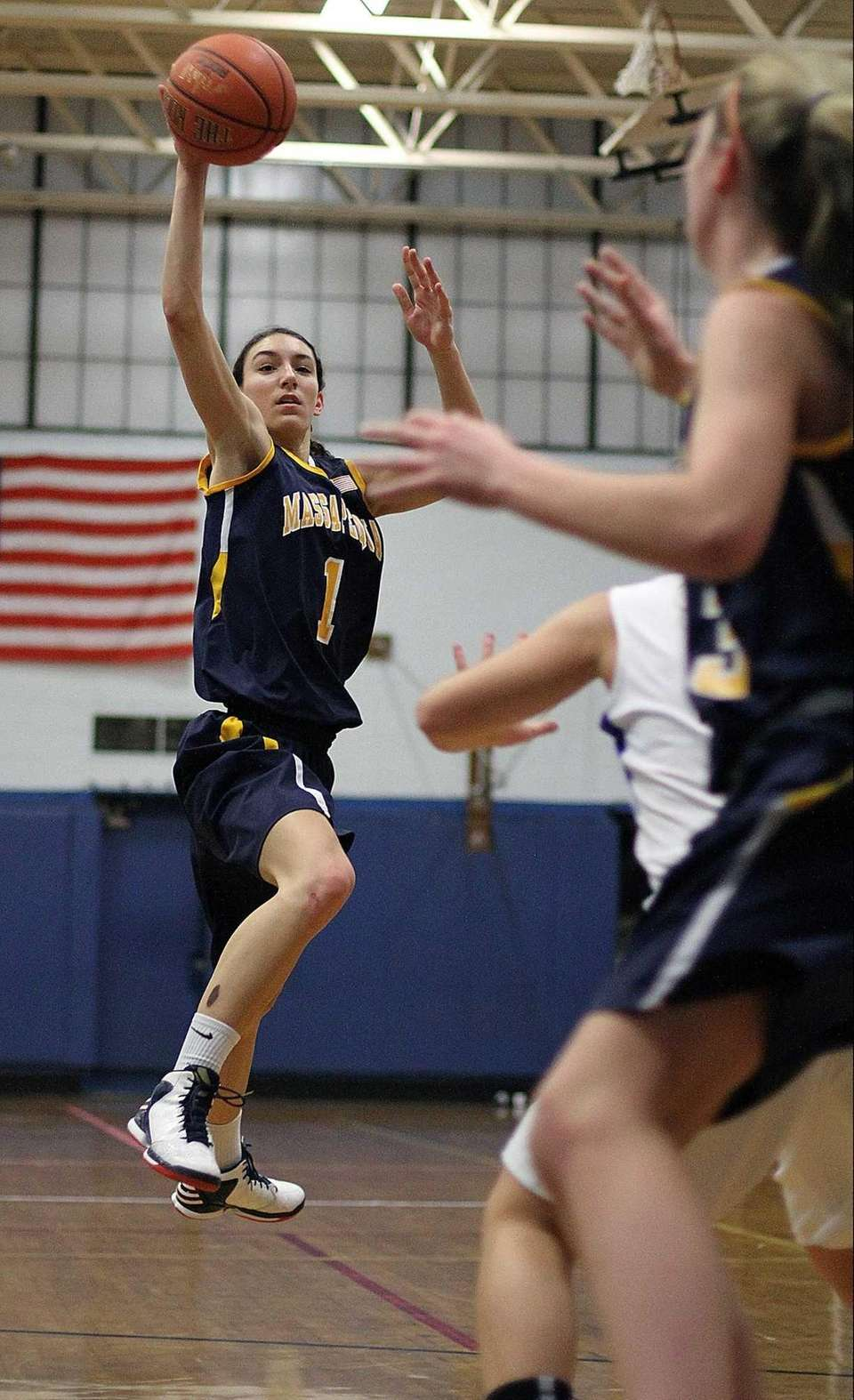 Massaequa's Morgan Roessler fires pass from outside during