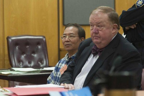 Dr. Stan Li, left, looks on as he