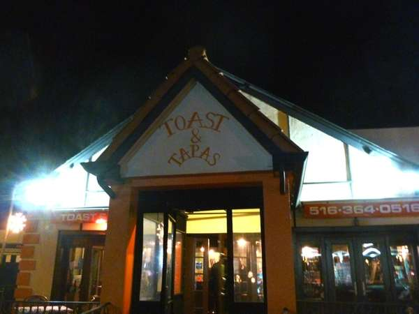 The exterior of Toast & Tapas in Syosset.