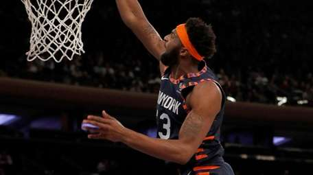 Mitchell Robinson of the Knicks dunks the ball