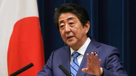 Japanese Prime Minister Shinzo Abe answers a question