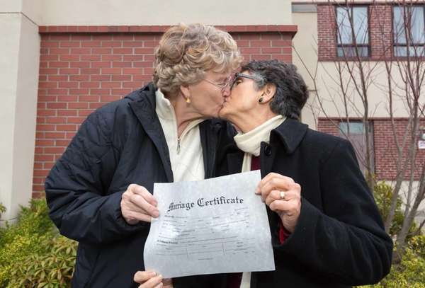 Retired Army Col. Grethe Cammermeyer, left, kisses longtime