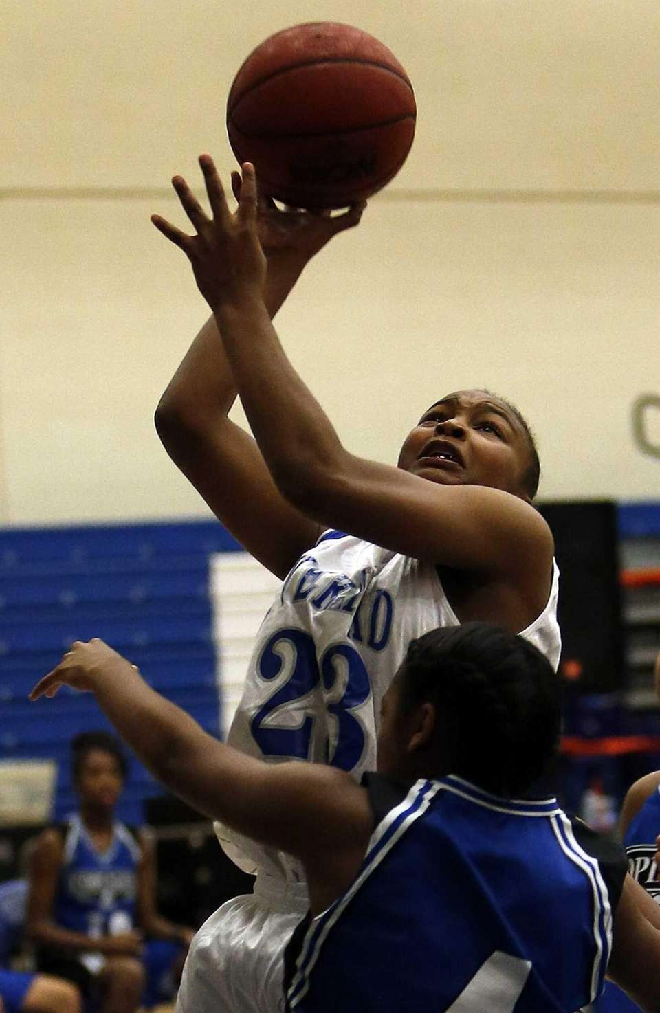 Riverhead's Shanice Allen goes for the layup over