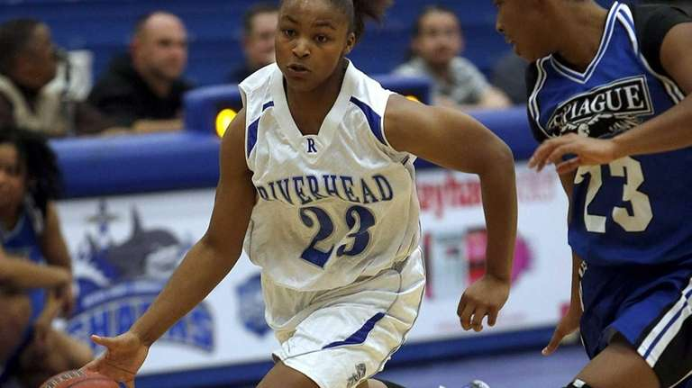 Riverhead's Shanice Allen drives against Copiague's I'Asia O'Garro