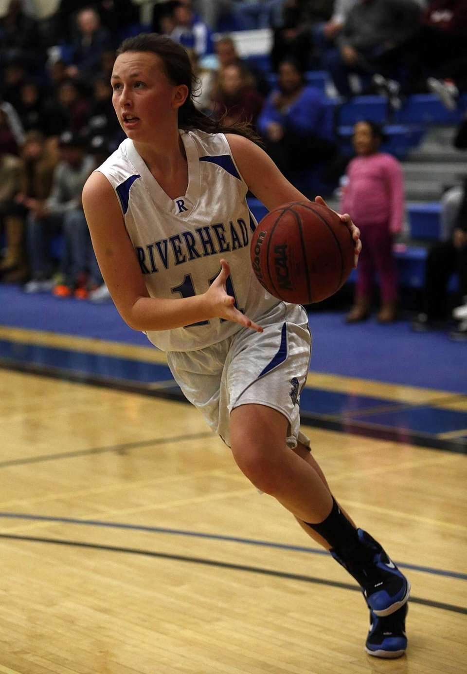 Riverhead's Jocelin Zaneski drives the baseline in the