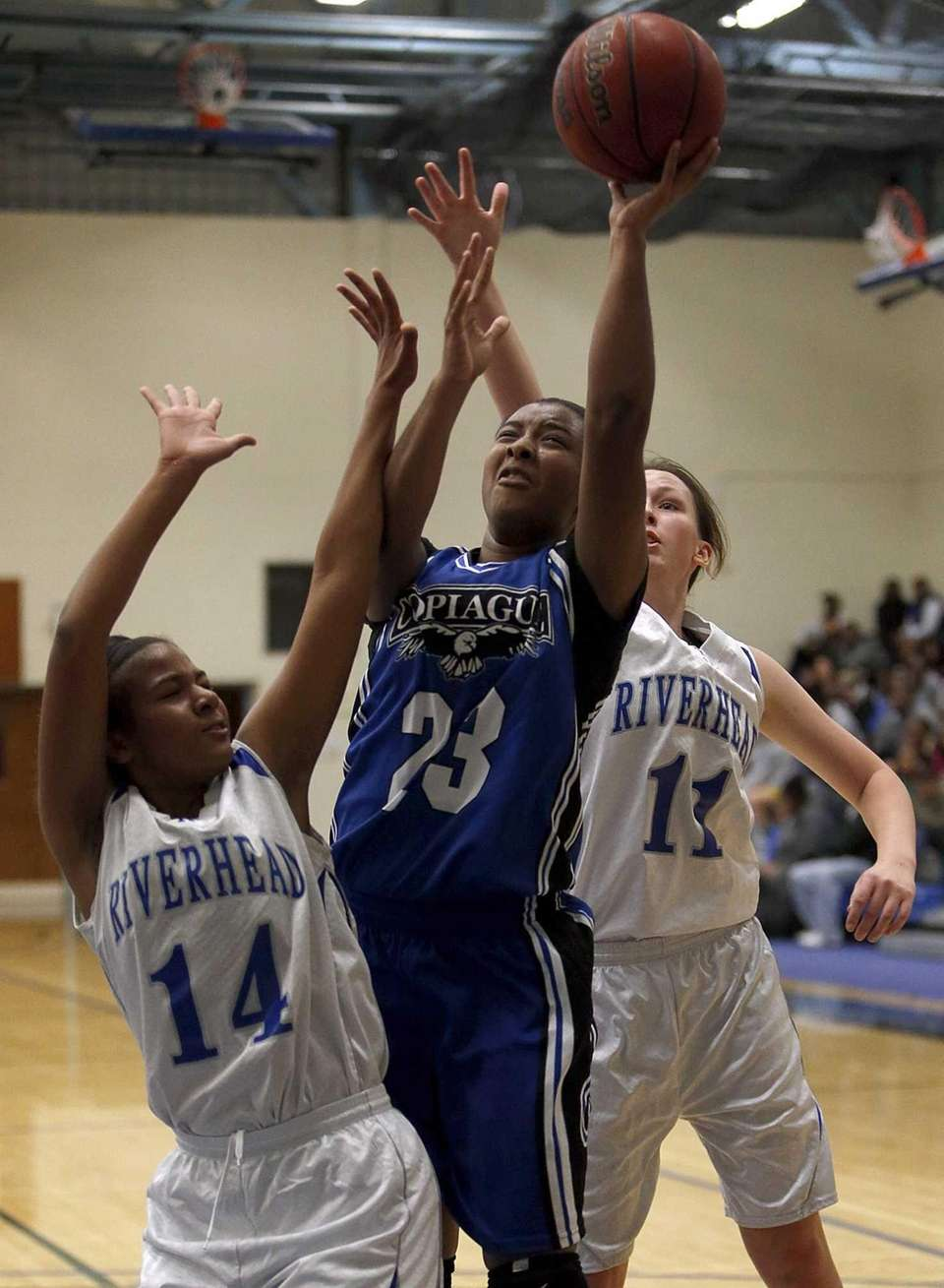 Copiague's I'Asia O'Garro drives to the hoop with