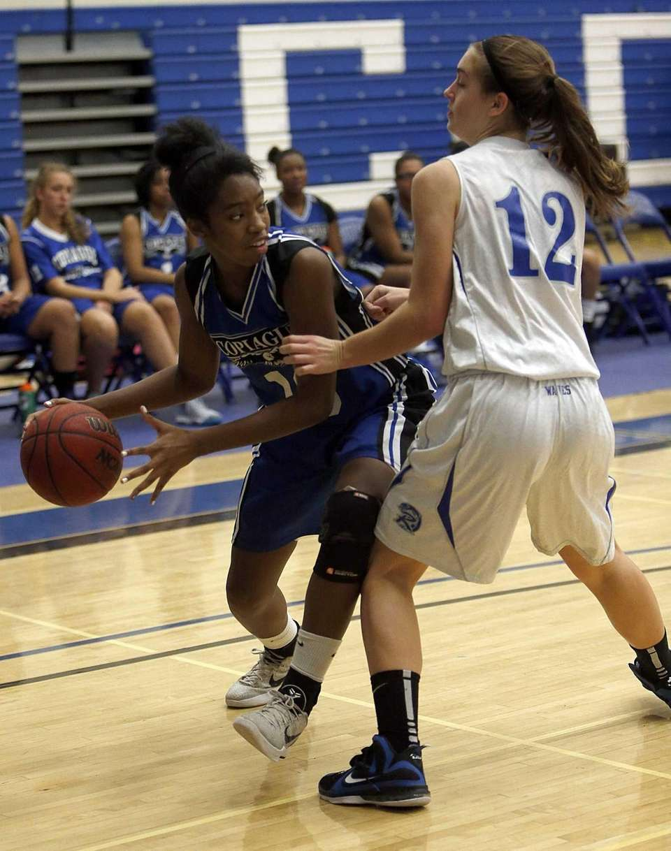 Copiague's Mikaiya Moore looks to pass around Riverhead's