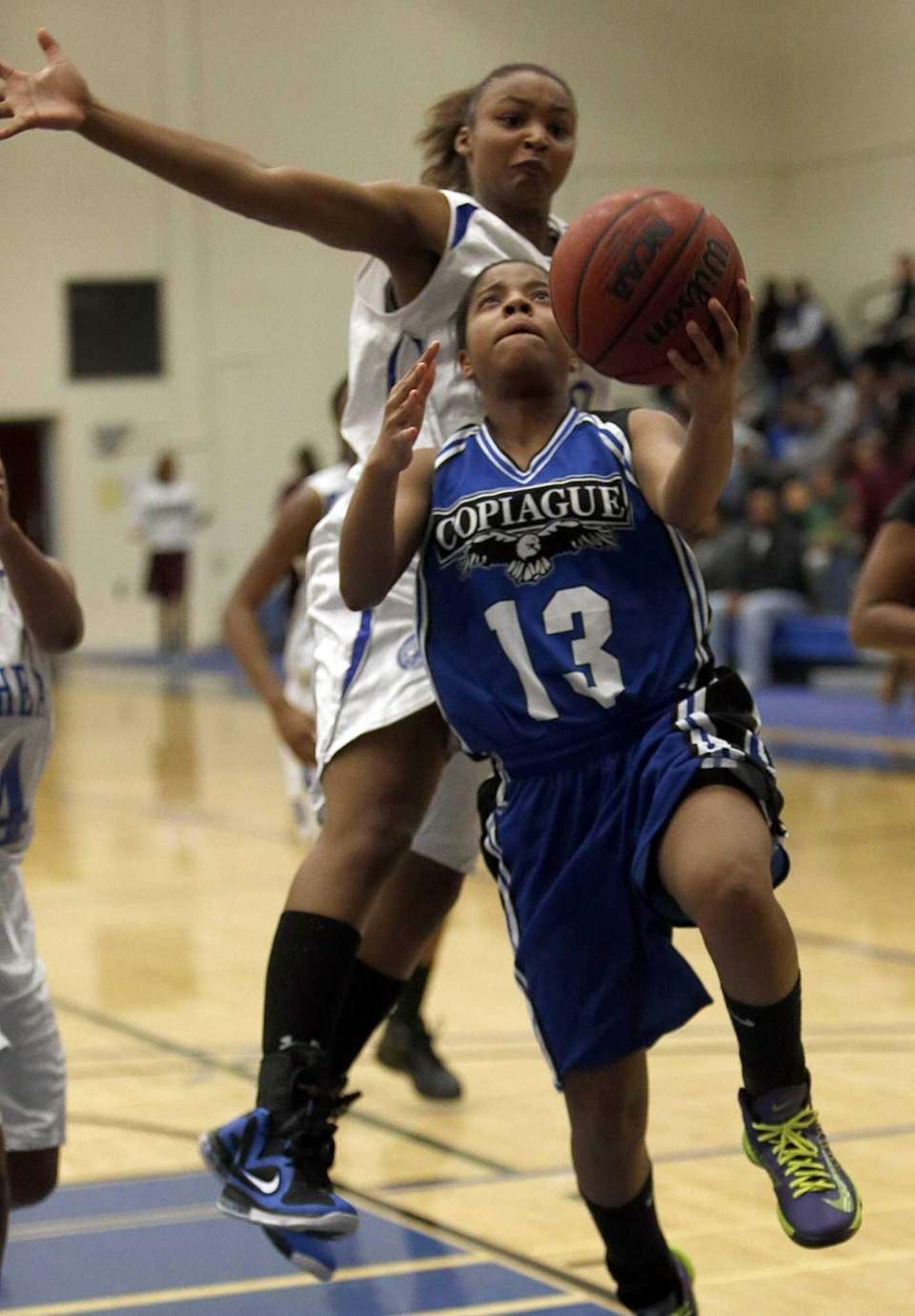 Copiague's Ihnacince Grady drives to the hoop with