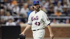 R.A. Dickey walks to the dugout after getting