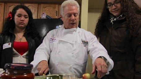 Amanda, left and Jasmine, participate with Richard Freilich,