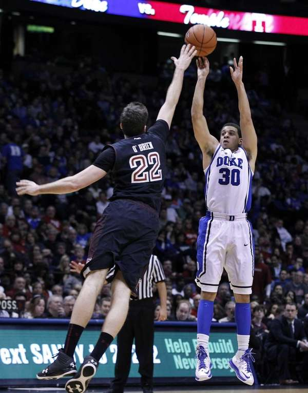 Duke guard Seth Curry takes a shot over
