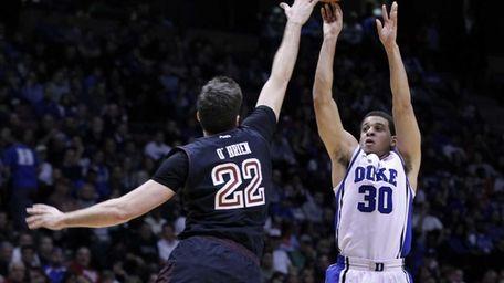Duke guard Seth Curry takes a shot over