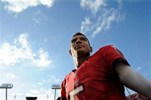 Tampa Bay Buccaneers quarterback Josh Freeman walks off