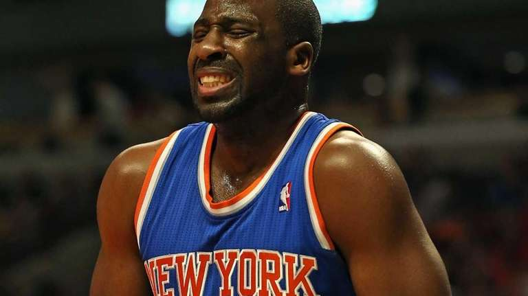 Raymond Felton holds his hand after suffering a
