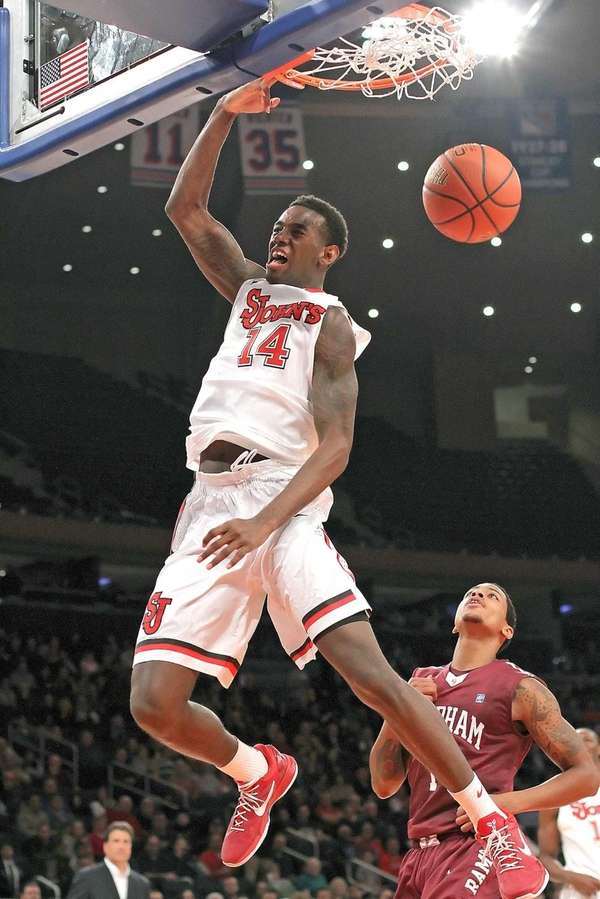 St. John's JaKarr Sampson slams dunks the ball