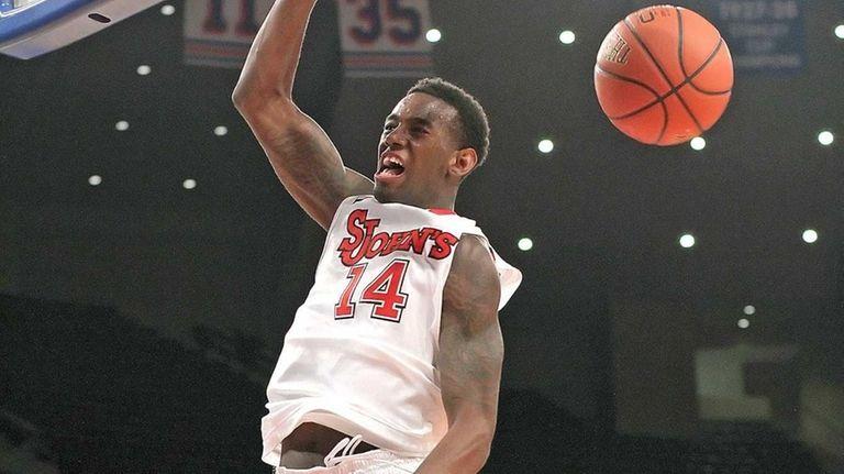 St. John's JaKarr Sampson slams dunks the ball