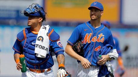 Mets catcher Wilson Ramos, left, and pitcher Jacob