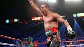 Juan Manuel Marquez celebrates after knocking out Manny