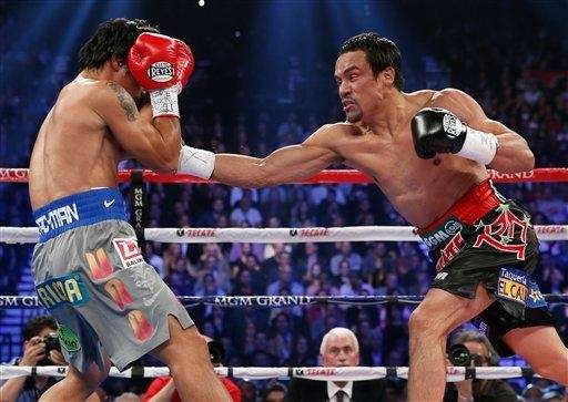 Juan Manuel Marquez, right, reaches for a punch