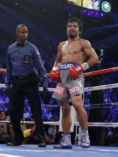 Manny Pacquiao lifts his trunks after being knocked