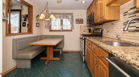 The kitchen has new countertops while the bathrooms