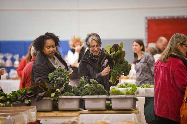 Customers shop at the Winter Farmers Market held