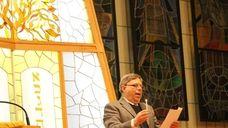 Rabbi Abraham Axelrud led the crowd gathered at