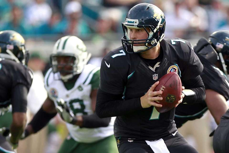 Jacksonville Jaguars quarterback Chad Henne looks to hand