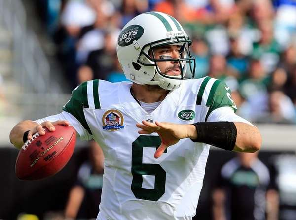 Mark Sanchez attempts a pass during the game
