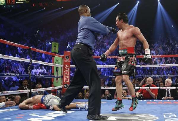 Referee Kenny Bayless, center, sends Juan Manuel Marquez,
