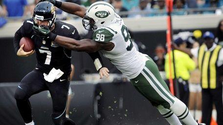 Jacksonville Jaguars quarterback Chad Henne is tackled by