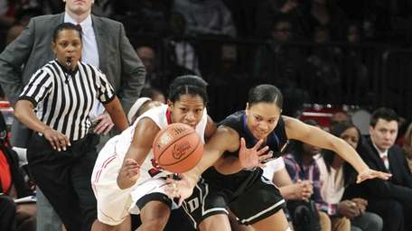 St. John's Briana Brown, left, fights for a