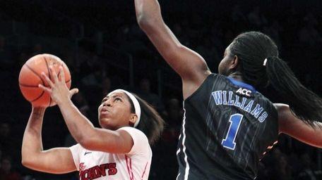St. Johns' Nadirah McKenith goes to the basket