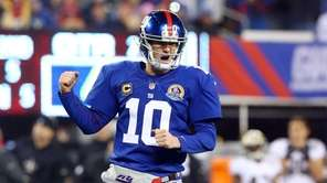 Eli Manning celebrates a touchdown pass to teammate