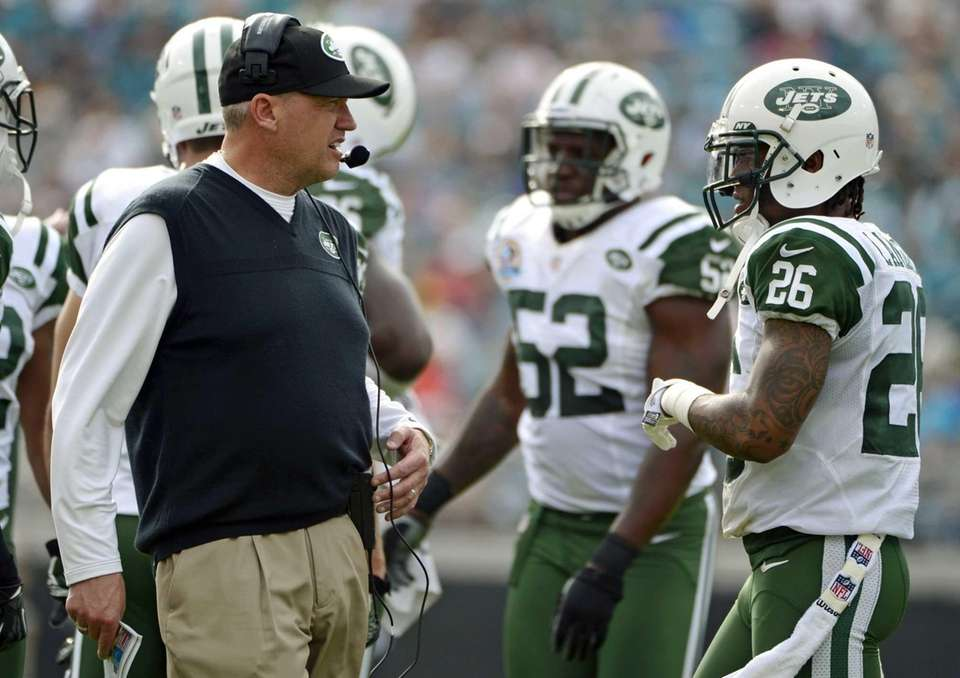 Jets head coach Rex Ryan, left, talks with