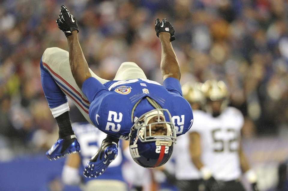 David Wilson of the Giants flips after returning