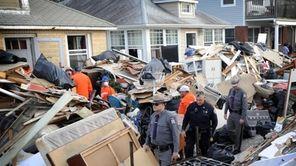 Debris is piled across Michigan Street in Long