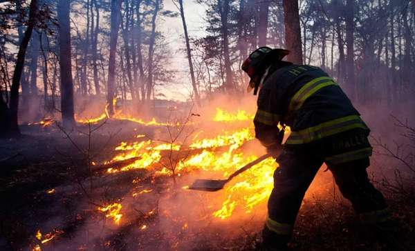 A firefighter battles a blaze off Wading River