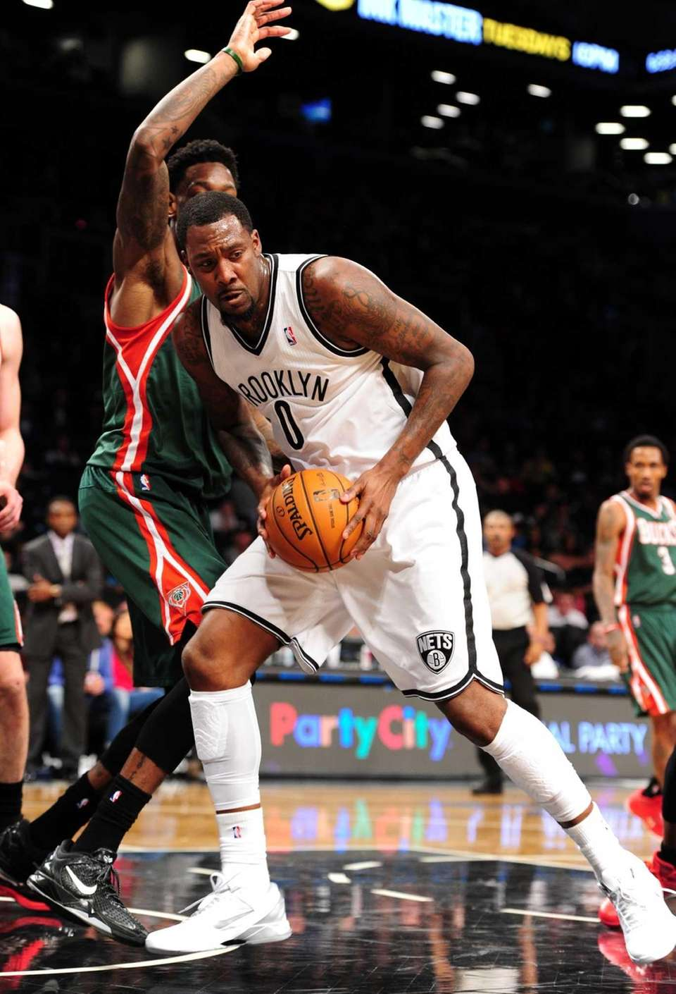 Andray Blatche of the Brooklyn Nets is guarded
