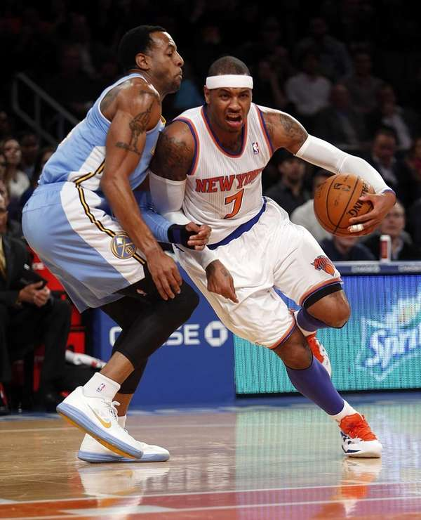 Carmelo Anthony drives against around Denver's Andre Iguodala